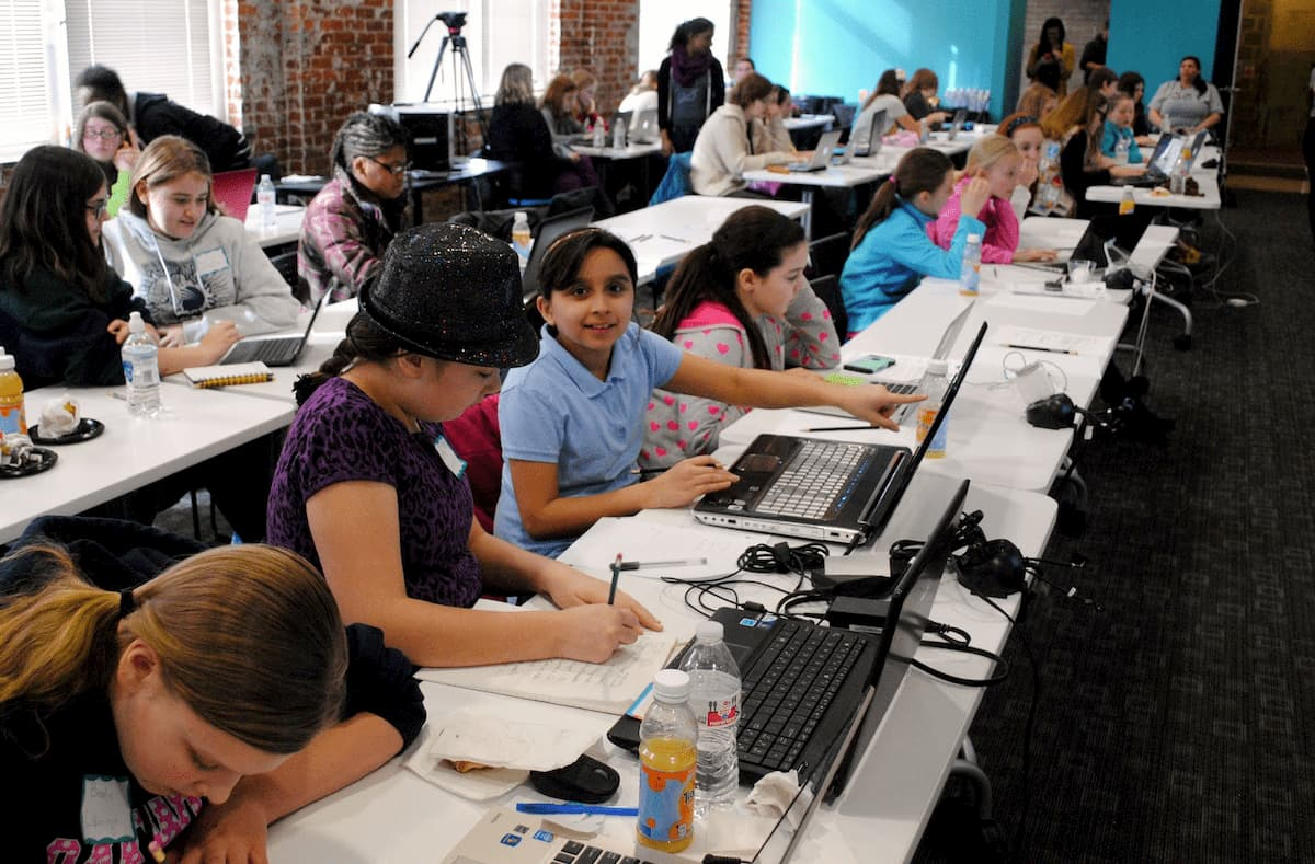 Excited Girl Scouts Building Websites